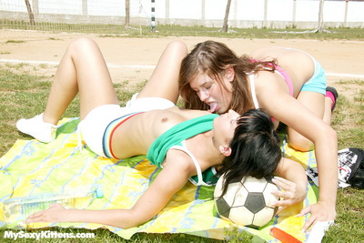 Sporty teen lesbian cuties playing with their pussys outside
